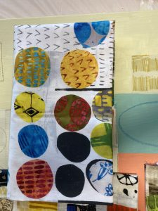 Graphic image of circles supports written text about fabrics